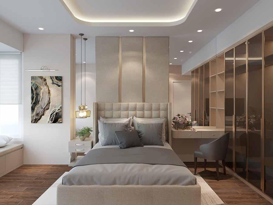 Sự tinh tế trong cách bày trí đèn trần, bàn trang điểm và tủ đầu giường mang lại không gian thư giãn thật tinh gọn cho gia chủ.