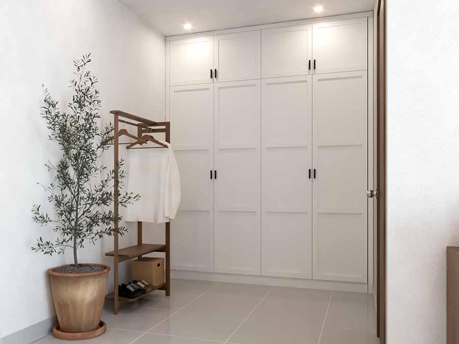 Tủ quần áo và giá treo quần áo đặt ngay bên cạnh cửa phòng ngủ, tiện lợi cho gia chủ khi sử dụng.