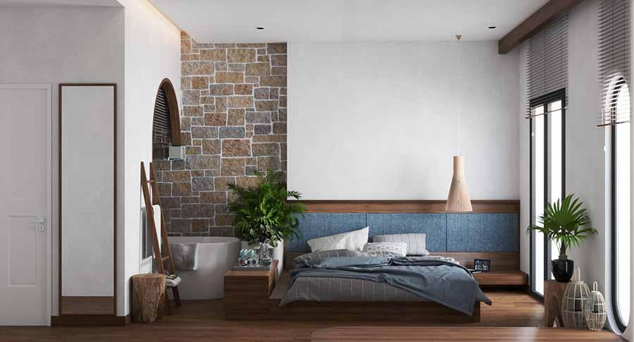 Kết hợp khéo léo tường đá và nền gỗ tạo điểm nhấn cho phòng ngủ.
