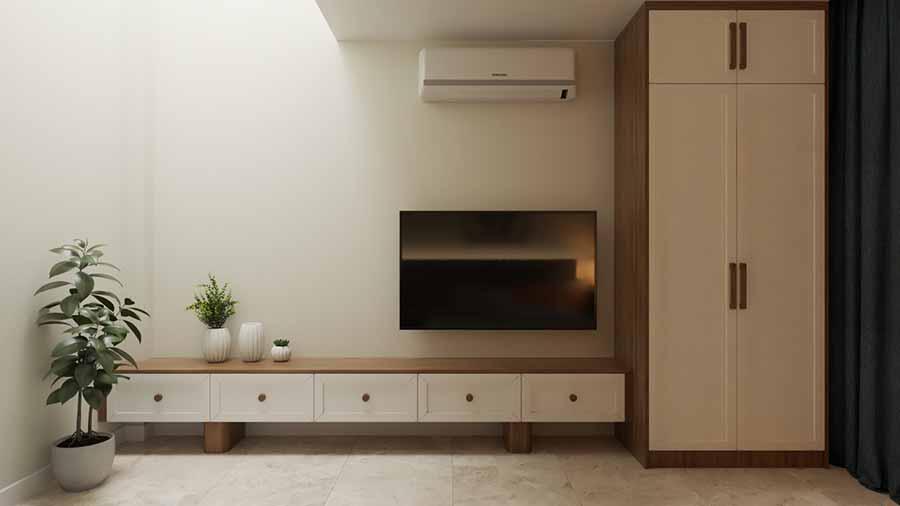 Tủ kệ tivi đơn giản mà sang trọng, bố trí nội thất sát tường khéo léo để lối đi được rộng rãi hơn.